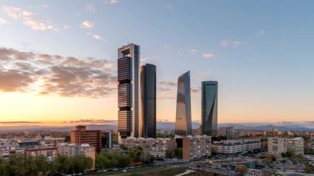 Madrid Spain time lapse 4K, city skyline day to night sunset timelapse at financial district four towers