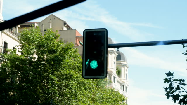 Madrid traffic light turns from red to green at central district intersection of the city. Spain. 4K