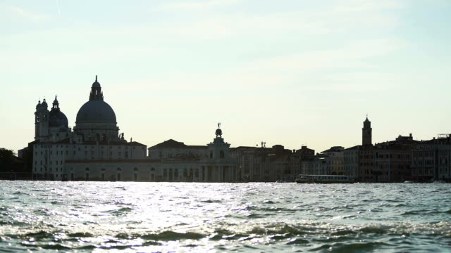 Magic hour in Venice, vaporetto sailing along Grand Canal, tourist attractions video