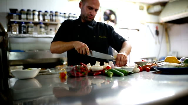 Magic in the kitchen The main chef cutting onion with a kitchen knife in the hotel restaurant commercial kitchen stock videos & royalty-free footage
