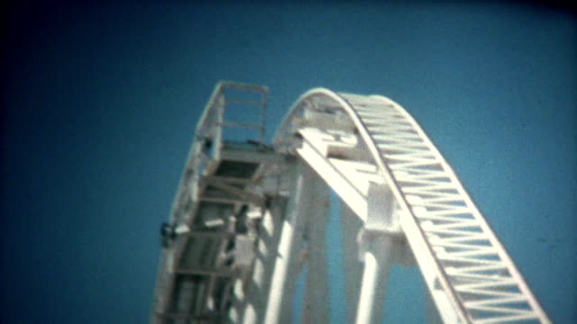 (8mm vintage) magic mountain roller coaster 1976 - roller coaster stock videos & royalty-free footage