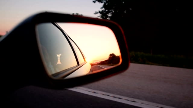 Magic sunset Sunset in the rearview mirror while the car is moving rear view mirror stock videos & royalty-free footage