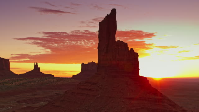 aerial magical monument valley at sunrise - parco nazionale video stock e b–roll