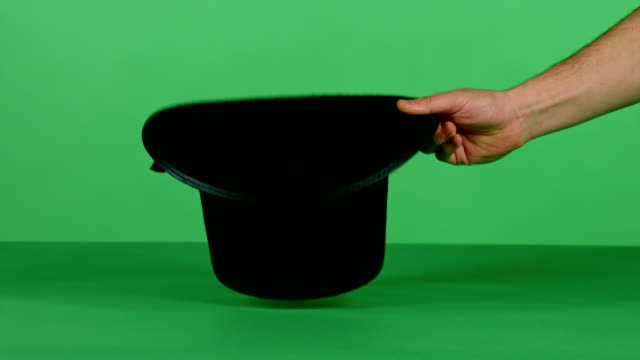 Magical trick with black top hat and a wand on green screen A magician does the trick with an empty black top hat and a magic wand in front of a green screen background / 1920x1080 HD, 30 fps, HD stick plant part stock videos & royalty-free footage