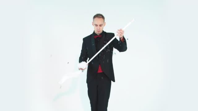 Magician showing a magic trick video