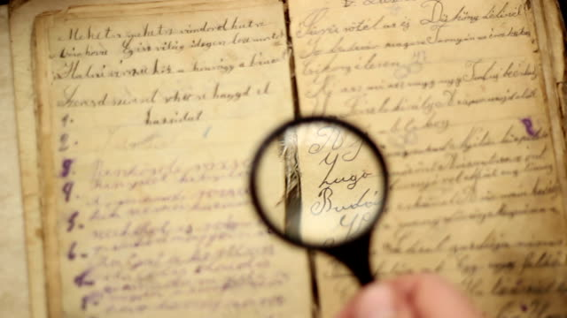 Magnifying glass and vintage book video