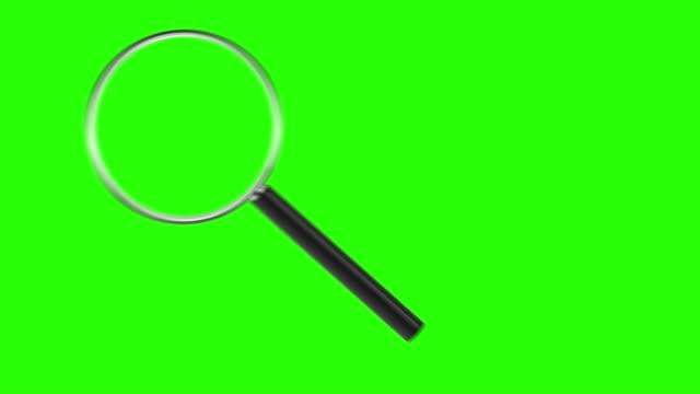 lupe isoliert auf grünem bildschirm. chroma-taste grün einfügen - lupe stock-videos und b-roll-filmmaterial