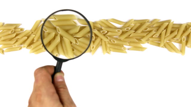 Magnifying glass motion  the macaroni Magnifying glass motion  the macaroni.HD uncooked pasta stock videos & royalty-free footage