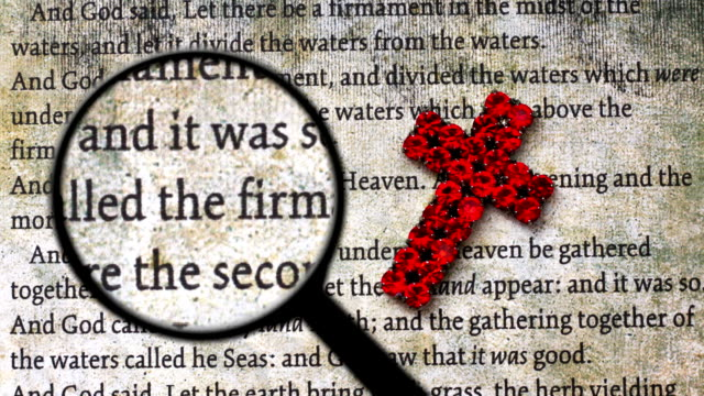 Magnifying glass on bible and cross of Jesus video