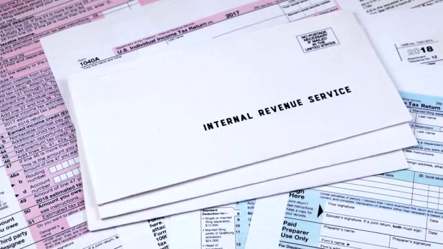 Mails from the Internal Revenue Service Human puts three mails from the Internal Revenue Service on 1040, Schedule D form 1040 and 1040a tax forms taxes stock videos & royalty-free footage
