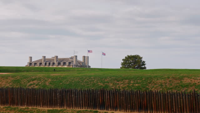 Main Building of Niagara Fort. Through brevenchasty palisade visible roof and three flags video