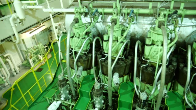 Main engine in engine room of large ship Main engine in engine room of large ship power supply stock videos & royalty-free footage