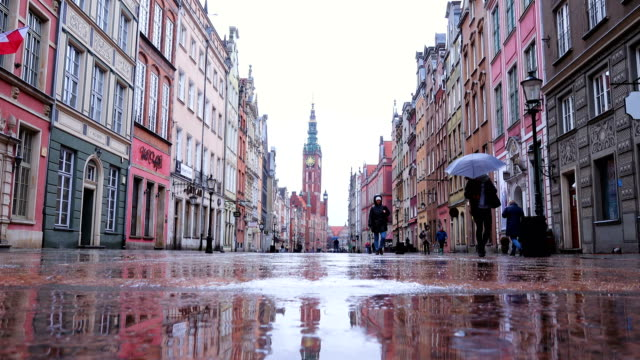 main street of Gdansk city old town at the rainy day GDANSK, POLAND, MARCH 05, 2019: low view of main street of Gdansk city old town at the rainy day gdansk stock videos & royalty-free footage