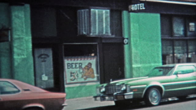 1971: Main street of town with five cent beer at local bar. video