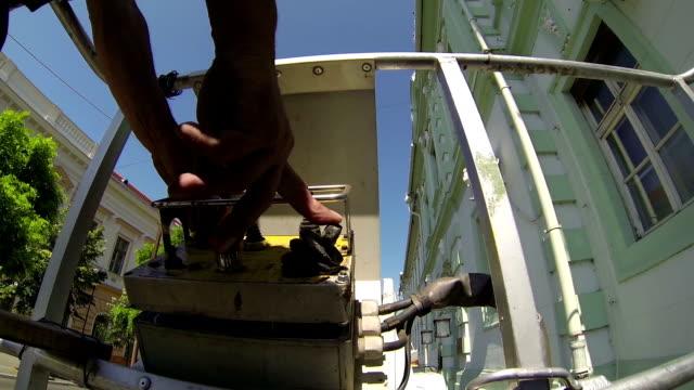 maintenance worker in the bucket of mobile crane - skylift bildbanksvideor och videomaterial från bakom kulisserna