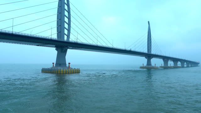 majestic bridge across sea - zhuhai video stock e b–roll