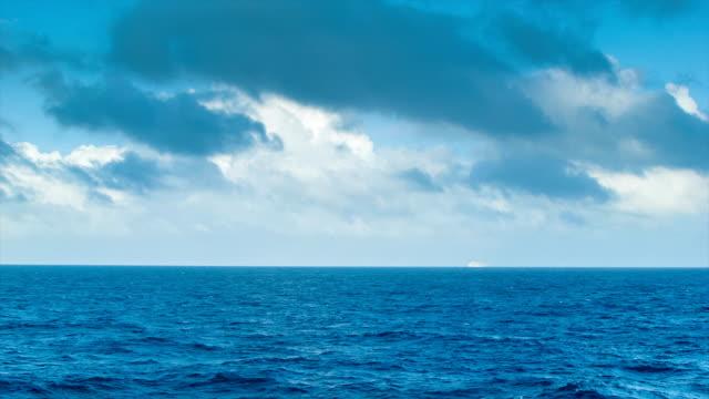 majestic long range seascape with cruise ship on horizon - vidbild bildbanksvideor och videomaterial från bakom kulisserna