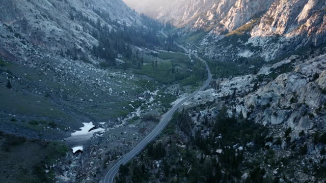 Majestic Sunset Streaking Through Mountain Pass in California video