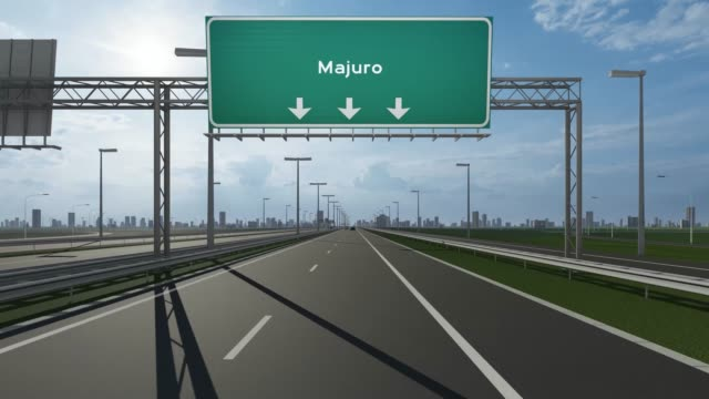 majuro city signboard on the highway conceptual stock video indicating the entrance to city - majuro video stock e b–roll