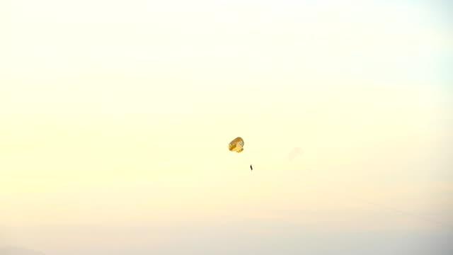 Make a parachute jump. video