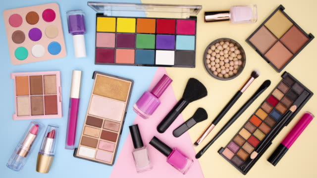 Make up products move one by one on pastel background - Stop motion