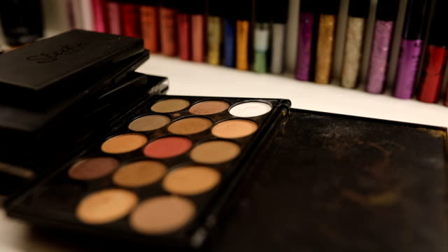 Make up workplace Make up artist workplace, multi-colored make up eqipment in make up studio, woman using make up. eyeliner stock videos & royalty-free footage
