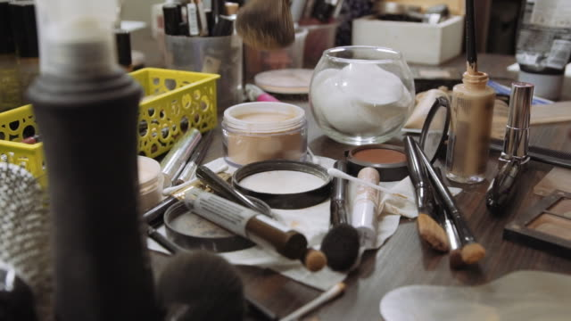 make-up artist applies powder on background Professional make-up tools. A set of brushes, lipsticks, shadows, carcass video