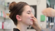 istock Make-up Artist Applying Make-up to a Young Adult Woman 1159773591