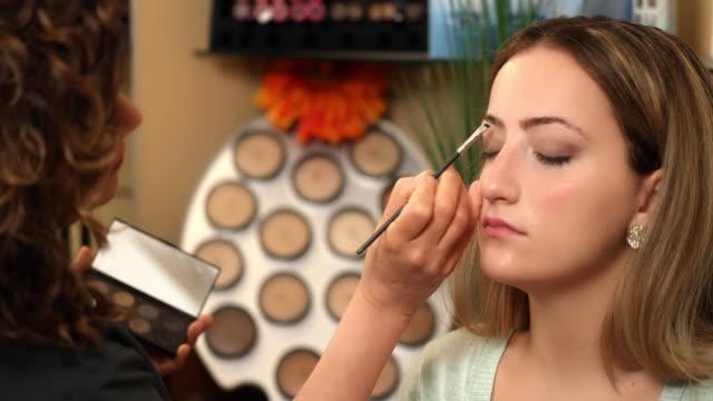 Make-up Artist Darkens Eyebrows Dolly Left video
