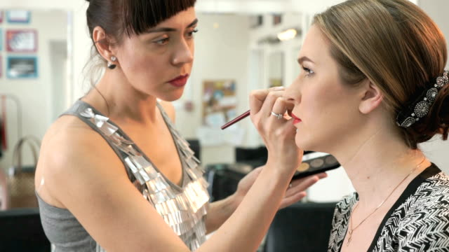 Makeup artist making make-up for stylish model video