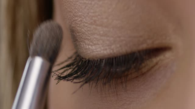 make-up artist puts foundation on brunette high fashion model`s skin. fashion video. - clavicola video stock e b–roll