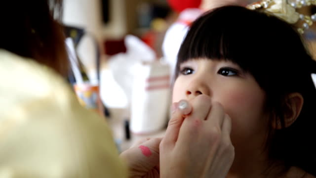 makeup artist working with young asian  child video