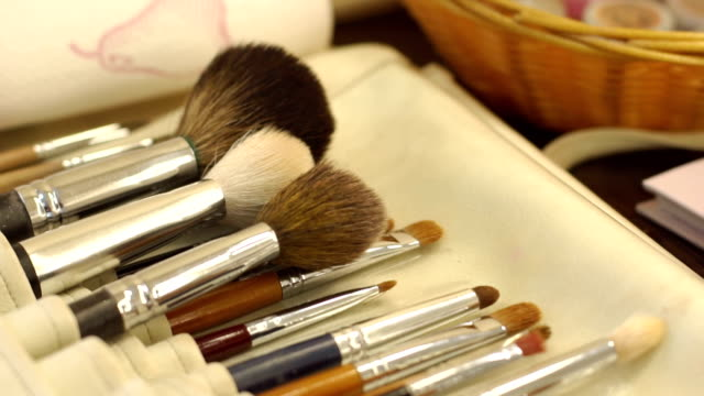 Make-up brushes in leather case, close-up. Makeup brushes in leather case. Various makeup brush set close-up. Makeup brush set. eyeshadow stock videos & royalty-free footage