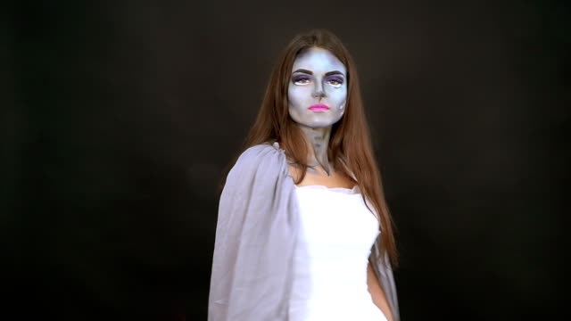 Makeup. Image of a witch in a bride dress video