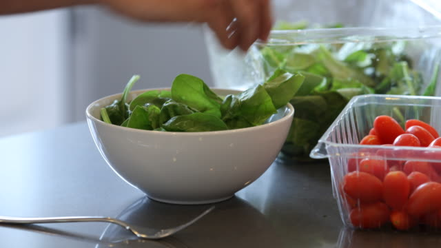 Making a healthy salad for lunch Making a healthy salad for lunch salad bowl stock videos & royalty-free footage