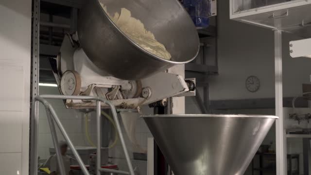 Making a loaf of bread in the bakery. Loaf of bread on the production line in the baking industry. Bread factory production. Bakery factory conveyor. Automated production of bread. Bakery industry