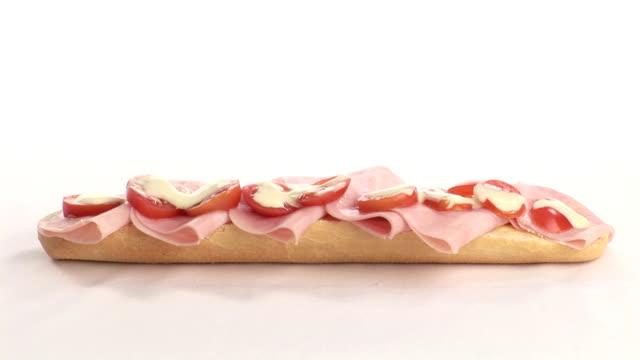 stockvideo's en b-roll-footage met making a sandwich - ham