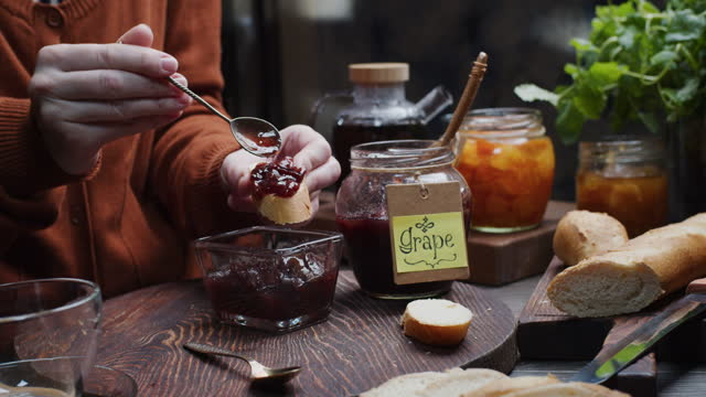 Making a toast with homemade jam for breakfast video