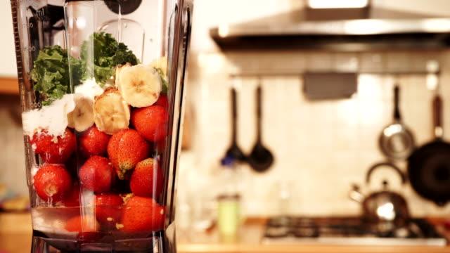 Making banana strawberry fruit shake in blender 4K