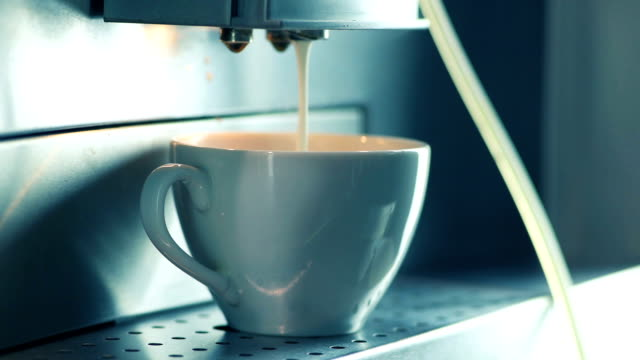 Making cappuccino in coffee maker video