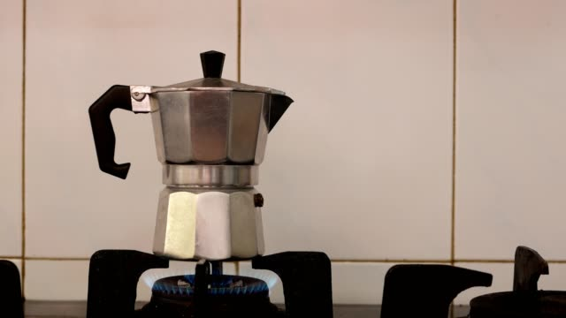 Making coffee with Moka pot on stove