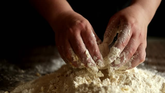 Making dough by female hands on wooden table background Making dough by female hands on wooden table background dough stock videos & royalty-free footage