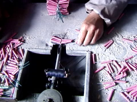 Making Fireworks Tying packs of firecrackers together Most people don't know that when they by fireworks imported from China that they are in fact buying a hand made item! This particular video shows a woman tying packs of 16 individual firecrackers together. firework explosive material stock videos & royalty-free footage