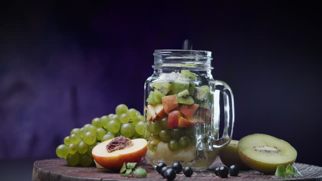 Making fruit salad in mason jar