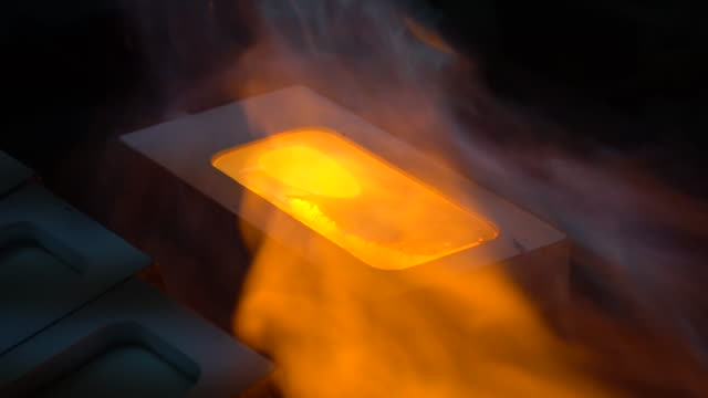 Making gold ingot, pouring liquid gold to plate Smelting scrap gold in blacksmith workshop ingot stock videos & royalty-free footage