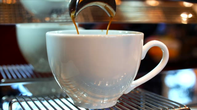 making ground coffee with tamping fresh coffee. close-up.tamping fresh ground coffee. professional barista. - espresso filmów i materiałów b-roll