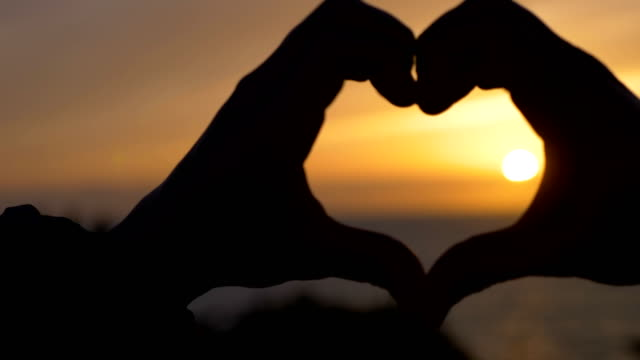 Making Heart Shape With Hands At Sunset. Love, Romance, dream