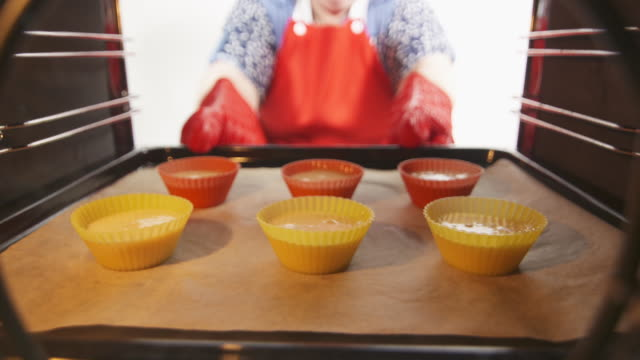 Making homemade muffins cupcakes in silicone baking molds step-by-step video