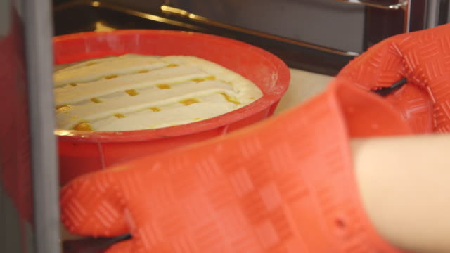 Making homemade Thanksgiving pumpkin pie with lattice top crust. Baking in oven video