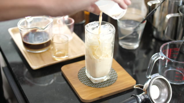 Making Ice Coffee, Pouring Milk into Ice